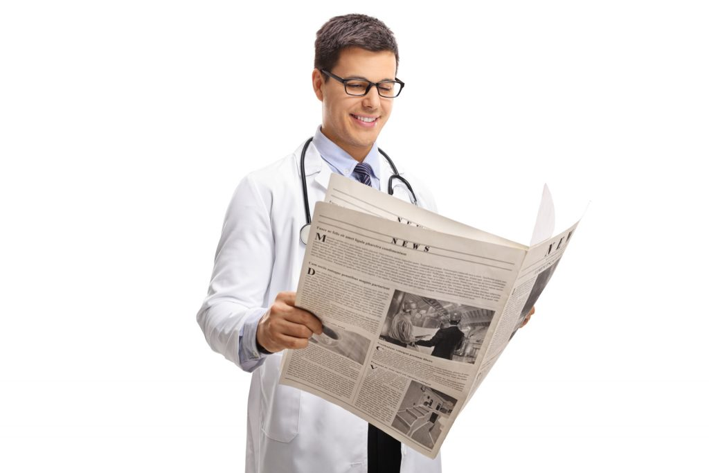doctor reading newspaper