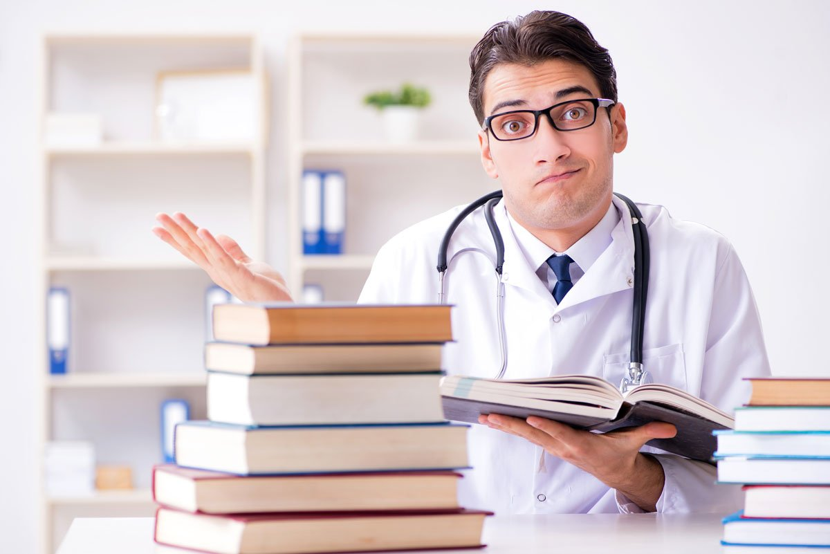 doctor studying books medical knowledge